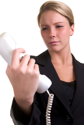 image of woman looking at telephone receiver